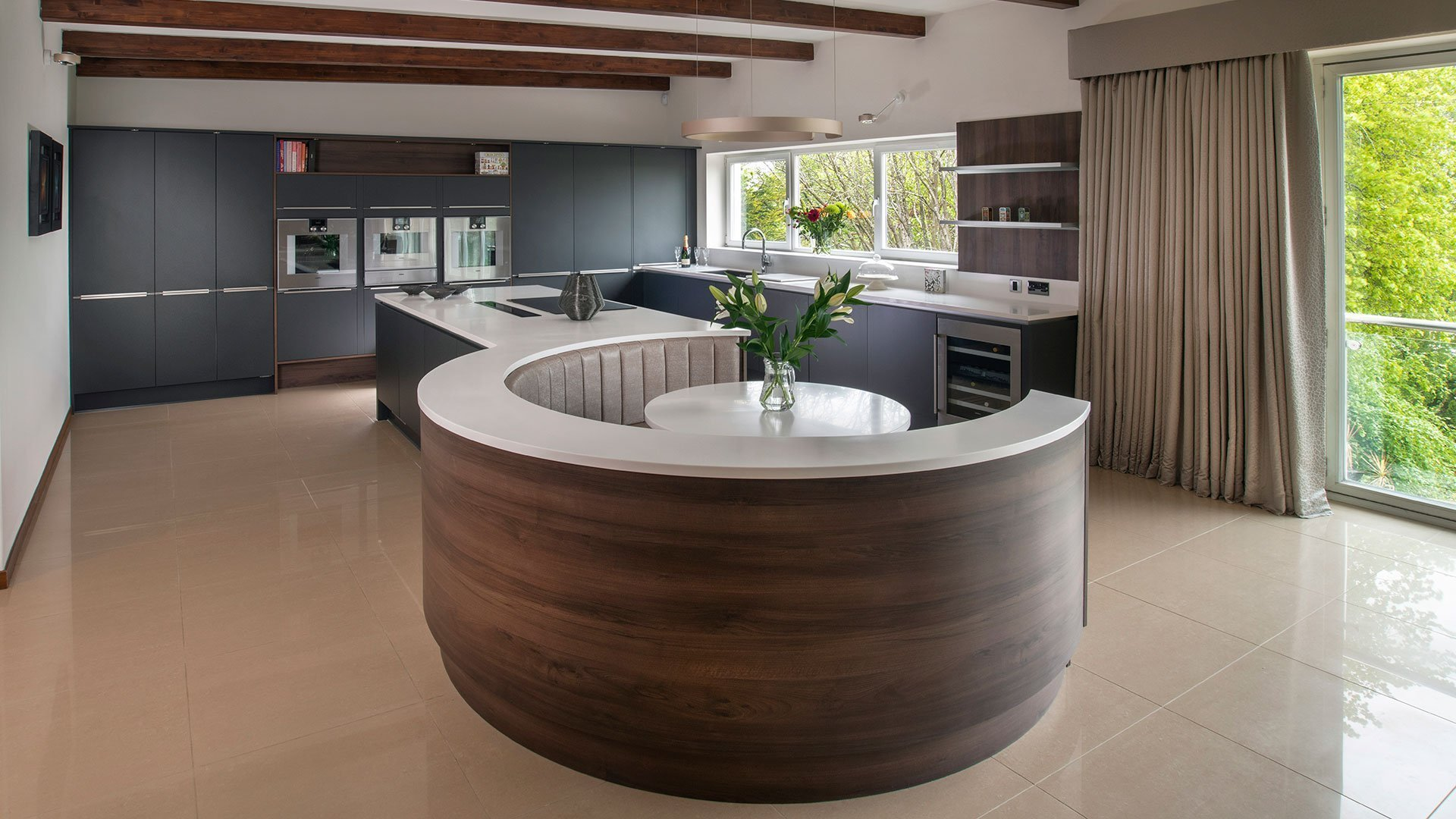 Corian® island with integrated curved seating area