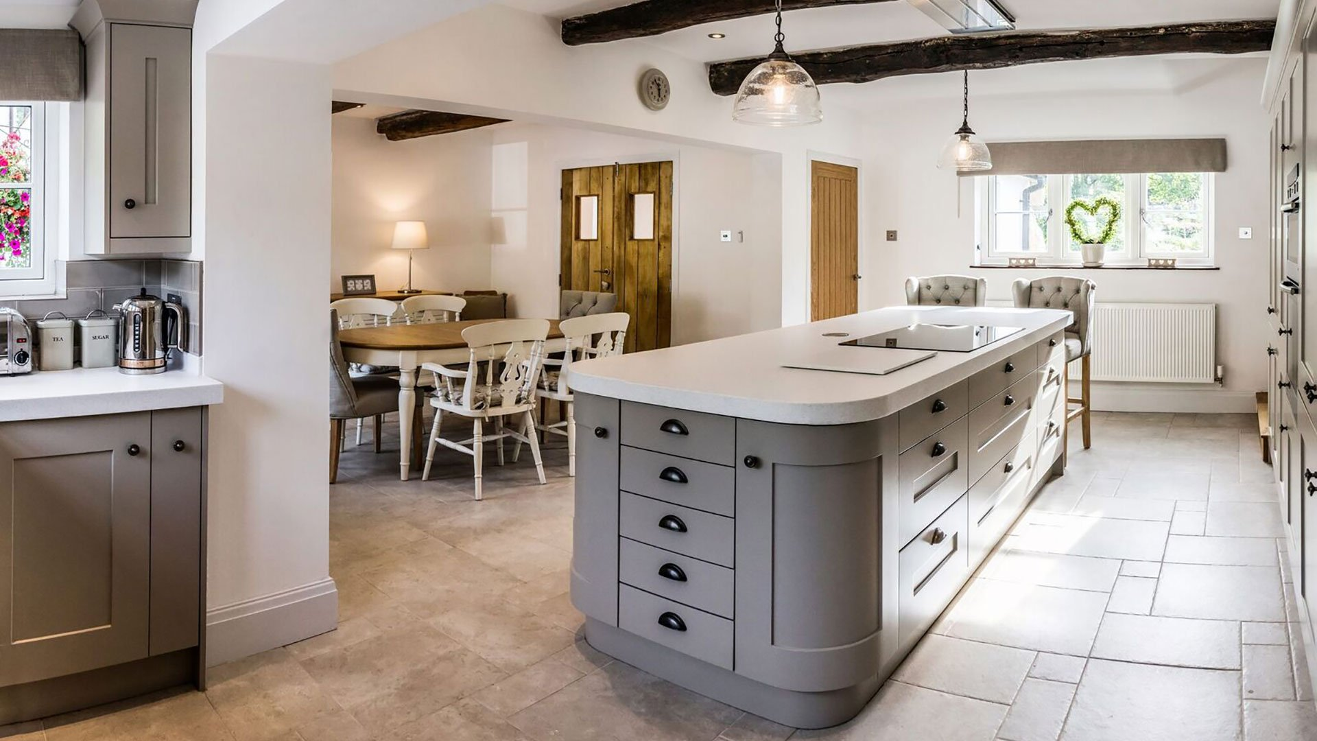 Traditional, shaker style kitchen with a Corian® island
